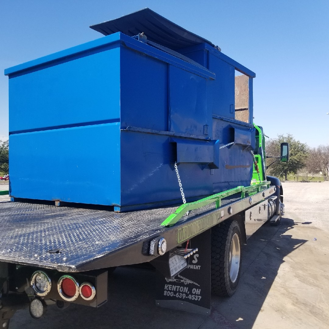 Towing a Dumpster for Maintenance
