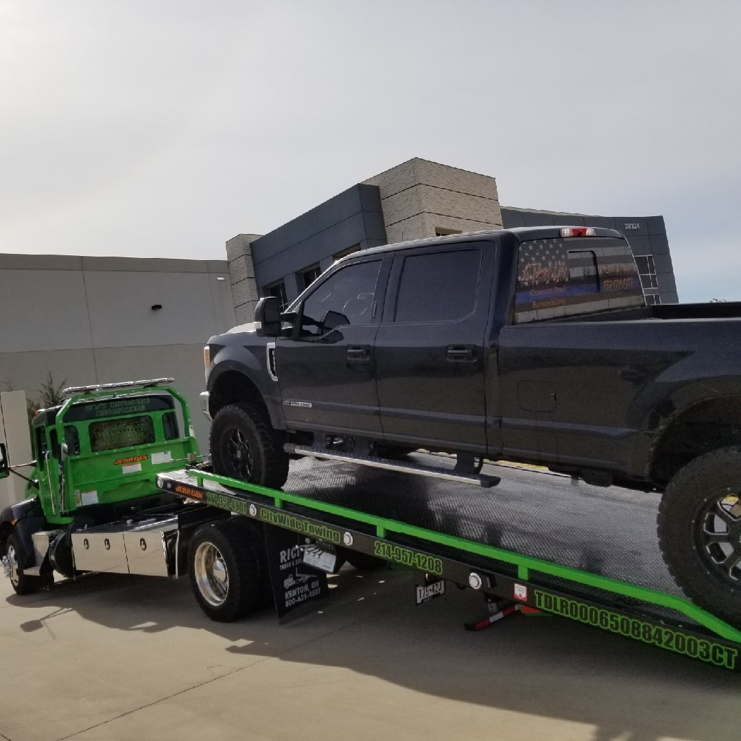 Towing a Truck from Dallas to Arlington to Replace a Bent Rim